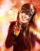 Photo of sexy young lady wearing black lace mask isolated on blur background, luxury woman holding g