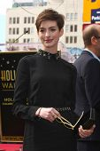 LOS ANGELES - DEC 13:  Anne Hathaway at the Hollywood Walk of Fame ceremony for Hugh Jackman at Holl