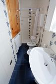 image of shower-cubicle  - a white interior of narrow toilet room - JPG