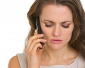 Portrait Of Concerned Woman Talking Mobile Phone