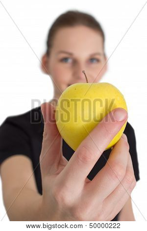 Woman Holding A Yellow Apple And Smiling