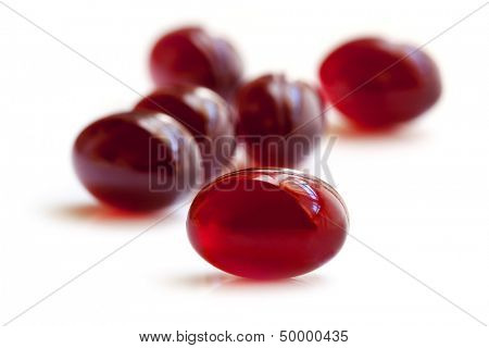Krill oil capsules, isolated on white.