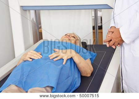 Senior woman under DPX machine for bone density measurement in a hospital