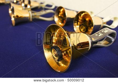 Large golden hand bells