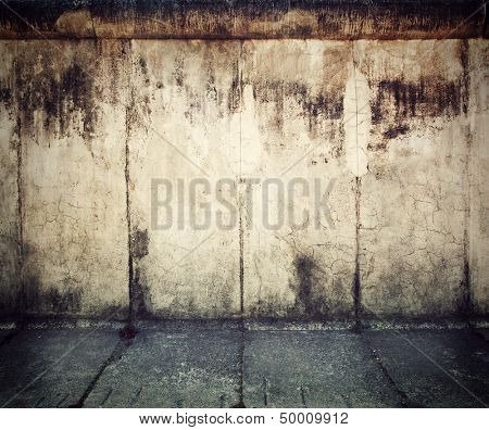 Grunge, rusty concrete wall and concrete floor. Grunge background
