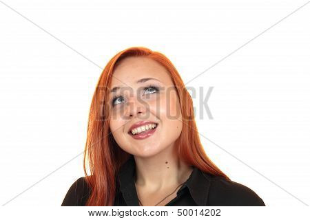 Portrait of a pretty smiling young woman looking up on white background