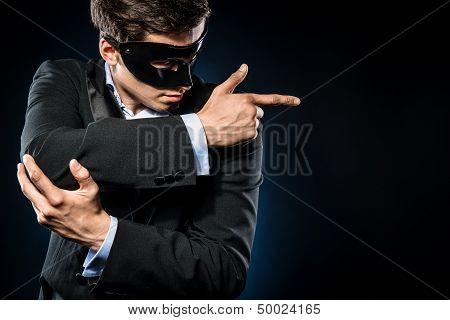 Elegant Man Wearing Black Mask Posing Indoors