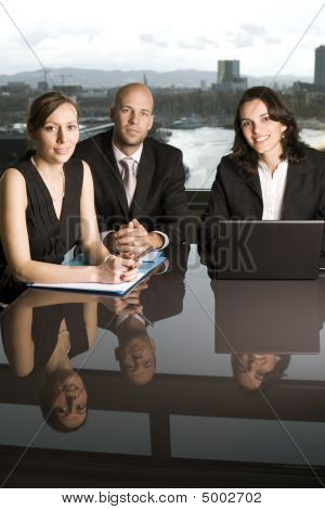 Business team of three people