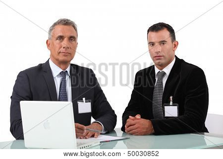 Two businessman at work.