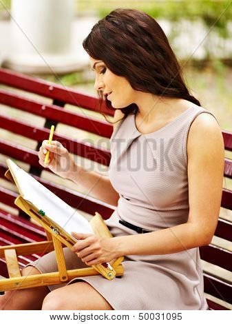 Girl  portray on bench at park  . Outdoor.