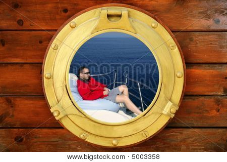 Man Relaxed On Bean Bag Over Blue Sea, Round Window