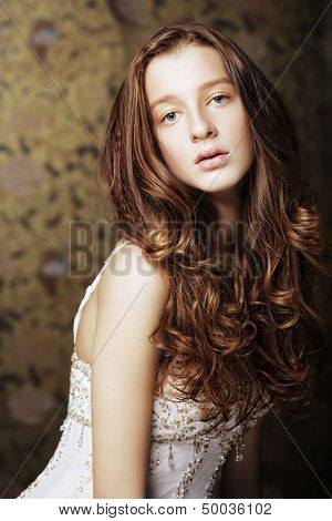 beautyful young woman with long curly hair