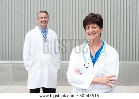 Mature Female Doctor With Colleague