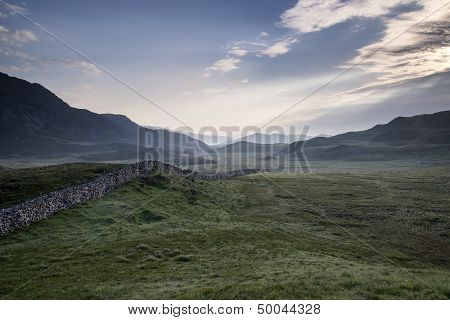 View Along Misty Valley Towards Snowdonia Mountains