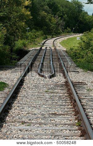 Tracks Around a Curve