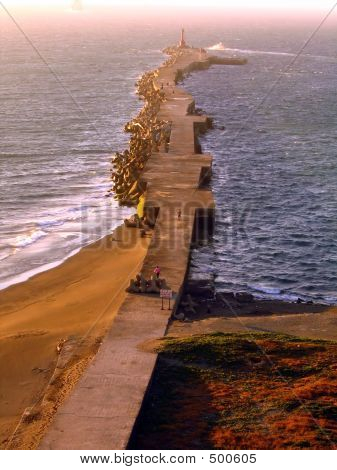 Long Breakwater With Concrete Blocks