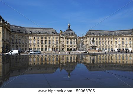 BORDEAUX, FRANCE - JUNE 27: Place de la Bourse reflected in the water mirror in Bordeaux, France on June 27, 2013. Opened in 2006, the pool is the largest water mirror in the world with 3450 sq. m.