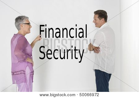 Couple discussing financial security against white wall with English text