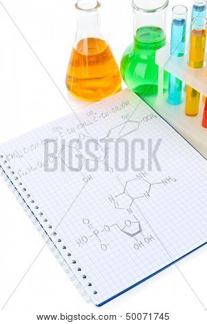 Test tubes with colorful liquids and formulas isolated on white