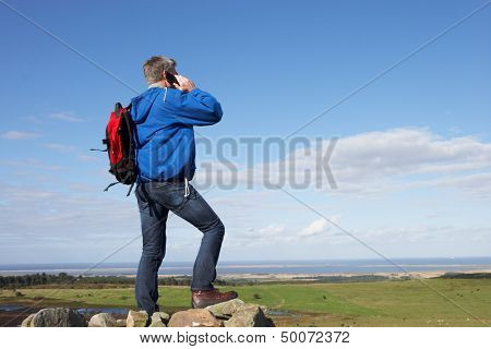 Man Using Mobile Phone In Remote Countryside