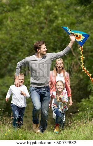 Family Flying Kite In Countryside