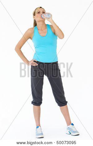 Studio Shot Of Exercising Woman Drinking Water