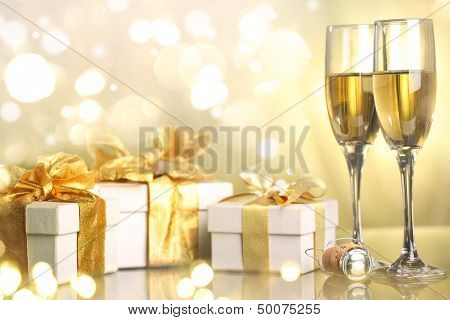 Champagne glasses and gifts ready to bring in the new year