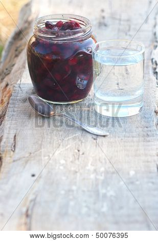 Preserve Of Berry And Tumbler With Water