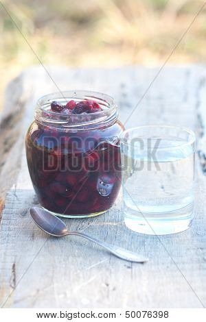 Pot With Preserve And Tumbler With Transparent Water