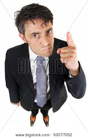 Humorous high angle portrait of a dogmatic businessman glaring at the camera and pointing his finger as he stresses his authority and point of view