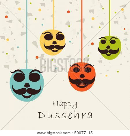 Indian festival Happy Dussehra concept with the hanging mask on celebration background.