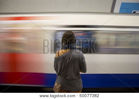 Lady waiting for a train