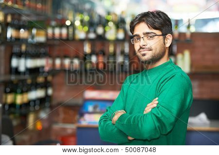 Portrait of Indian sikh man seller with bushy beard at shop