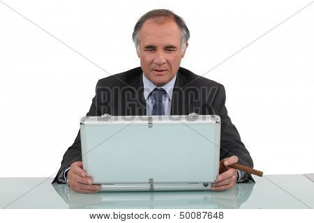 Businessman looking in a briefcase
