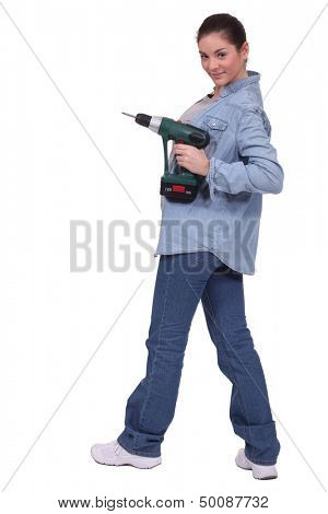 sexy craftswoman holding a drill