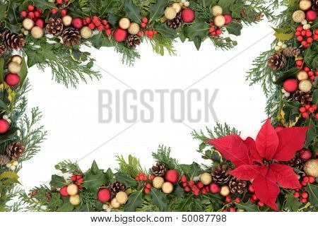 Christmas floral background border with red poinsettia flower, baubles, holly, mistletoe and winter greenery over white.