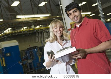 Portrait of young male and female make inventory in the newspaper factory