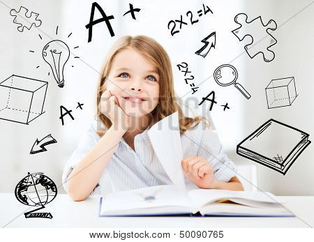 education and school concept - little student girl studying at school