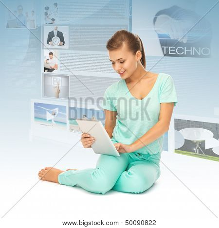 picture of young girl sitting on the floor with tablet pc