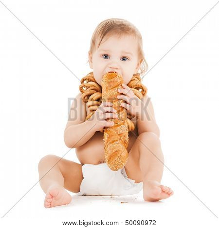 childhood and food concept - cute todler eating long bread