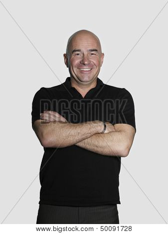 Portrait of confident middle aged man with arms crossed on white background