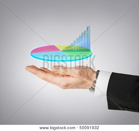 business and finances - businessman hand showing raising virtual chart