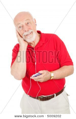 Senior Man Listens To Mp3S