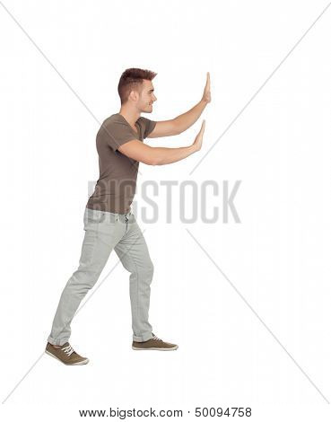 Young man pushing something isolated on a white background