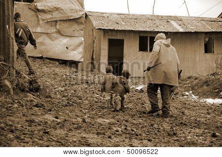 people walk in mud