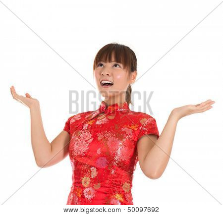 Pretty Asian woman with Chinese traditional dress cheongsam or qipao open arms looking up surprisingly. Chinese new year concept, female model isolated on white background.