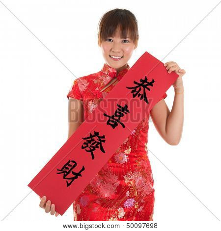 Asian woman with Chinese traditional dress cheongsam or qipao holding couplet, the Chinese word means congratulations and best wishes for a prosperous New Year. ?solated on white background.