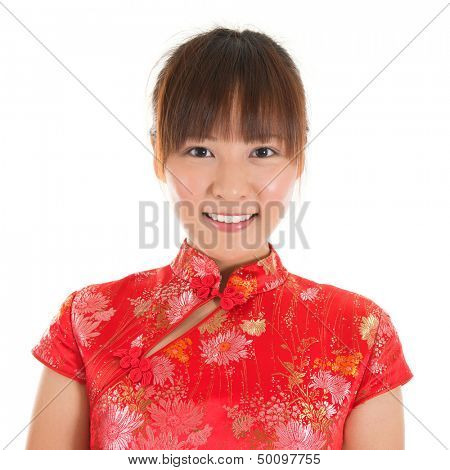 Asian woman with Chinese traditional dress cheongsam or qipao, close up face shot. Chinese new year concept, female model isolated on white background.