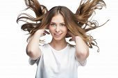 funny young woman with flying hair