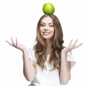 young beautiful brunette woman with green apple